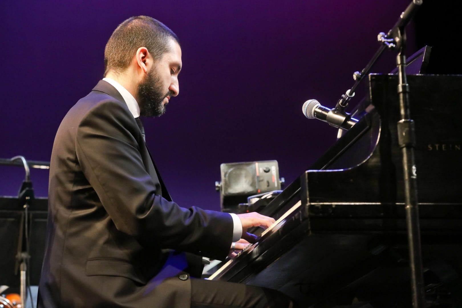 <h3>Ibrahim Maalouf performing on the piano.</h3>